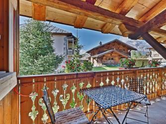 Zuidgelegen balkon van kamer Les aigles