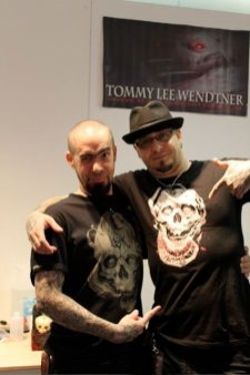 Guy and Tommy Lee Wendter posing with two different Labo-O-Kult t-shirts