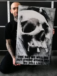 "Guy Labo-O-Kult with his painting ""one day or another"""