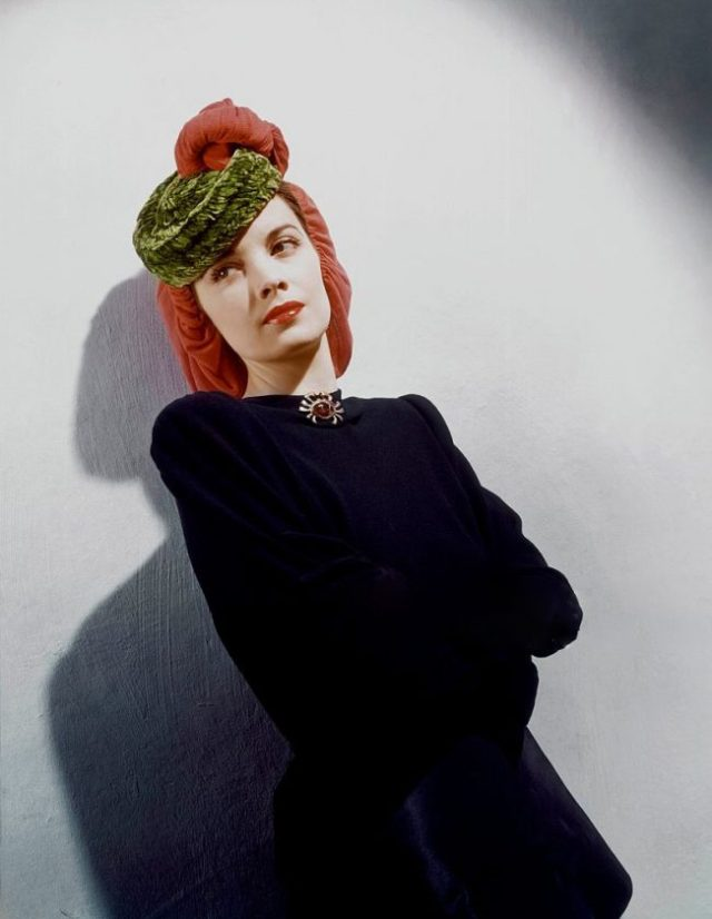 Model in wool jersey snood with chenille pill-box *** Local Caption ***
