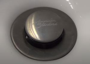 how to remove bathroom sink drain flange