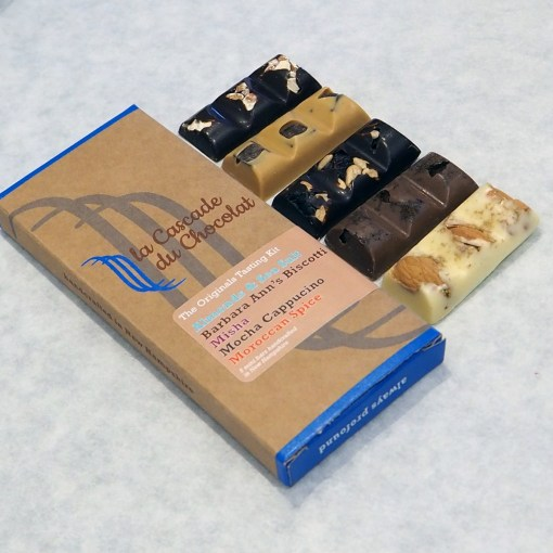 Photo of selection of mini chocolate bars based on La Cascade du Chocolat's original flavors taken at an angle