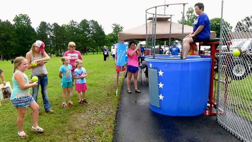 Chief of Police, BeLinda Shelton raises money for the City of Hector by taking a turn in the dunk tank. Photo by Lacey Keenan ©2016