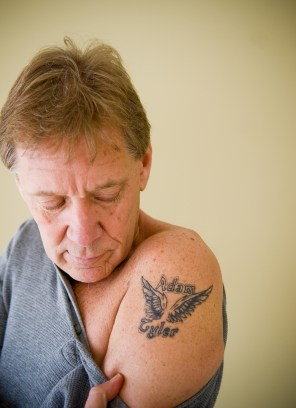 Teddy Johnson displays a tattoo in memory of his son, Adam, who died of a heroin overdose in 2007 at the age of 22.