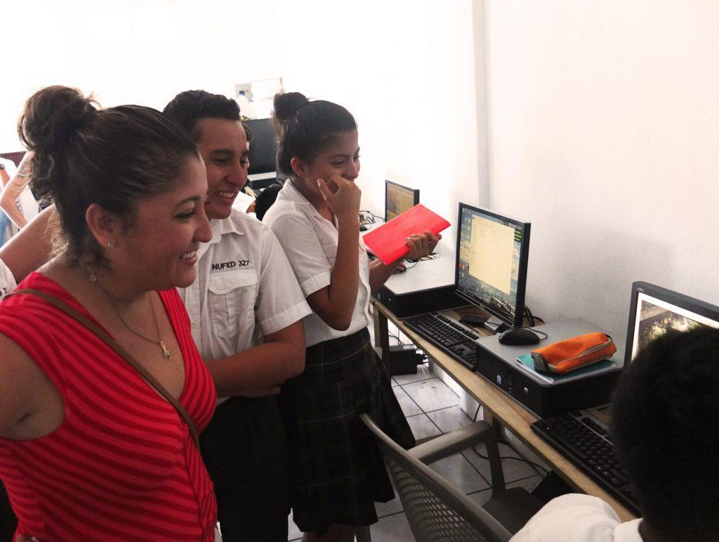 students show parents computers guatemala
