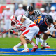 May 21, 2011; Hempstead NY, USA; Cornell Big Red midfielder Doug Tesoriero (16) and Virginia Cavaliers midfielder Garrett Ince (15), battle for a faceoff in the first quarter during the quarterfinal round of 2011 NCAA mens lacrosse tournament at James M. Shuart Stadium. Mandatory Credit: Andrew Fielding-US PRESSWIRE