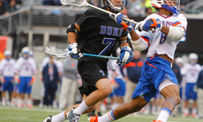 Apr 1, 2012; East Rutherford, NJ, USA; Syracuse Orange midfielder Hakeem Lecky (8) opens the game with a goal against Duke Blue Devils midfielder Jake Tripucka (7) at the Big City Classic at MetLife Stadium. Mandatory Credit: Jim O'Connor-USA TODAY Sports