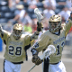 May 20, 2012; Chester, PA USA; Note Dame Fighting Irish attack Westy Hopkins (12) celebrates his goal with teammates Conor Doyle (28) against the Virginia Cavaliers during the 1st half of the NCAA Division I Men's Lacrosse Quarterfinals at PPL Park in Chester. Mandatory Credit: Eric Hartline-USA TODAY Sports