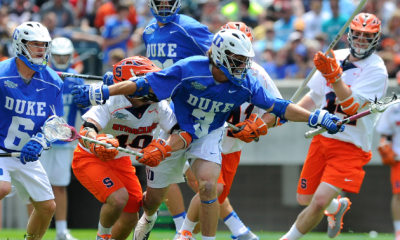 May 27, 2013; Philadelphia, PA, USA; Duke Blue Devils midfielder Brendan Fowler (3) reaches for a loose ball around a group of Syracuse Orange defenders during the second quarter of the 2013 NCAA Division I Men's Lacrosse Championship Game at Lincoln Financial Field. Duke won the game 16-10. Mandatory Credit: Rich Barnes-USA TODAY Sports