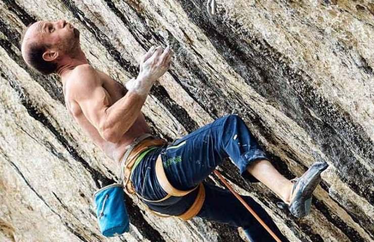 Cédric Lachat climbs Sweet Neuf (9a +) in Pierrot Beach