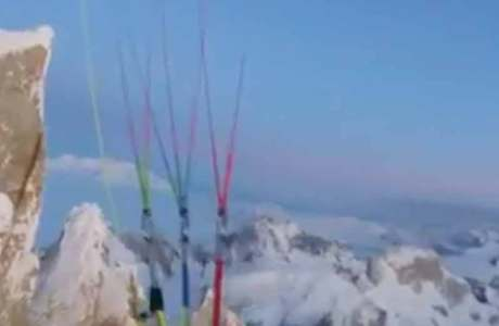 Fabi Buhl starts with a paraglider from the top of Cerro Torre