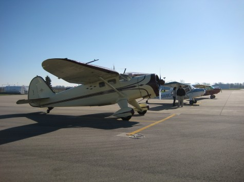 Geez, that's one big taildragger next to those Champs!