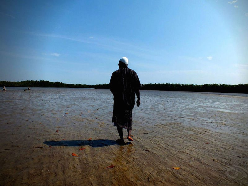 Sunkary Badji, then major of Brikama. All of us stranded on an island in the middle of the river Gambia as our boat floated away.