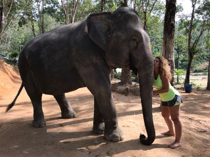 Amanda kisses an elephant at the Elephant Jungle Sanctuary, Phuket, Thailand