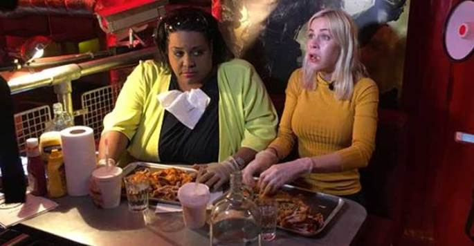 Alison Hammond and Kate Lawler taking on the hot wings