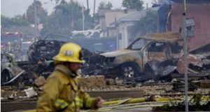 Two killed as plane crashes into homes in California