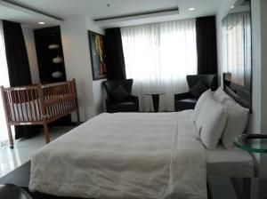 Amari Nova Suites Pattaya bedroom