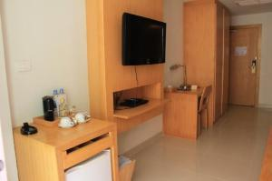 Aspery Hotel room view of amenities with TV and desk