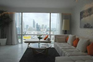 Pullman Bangkok Hotel G living room with sofa and a view