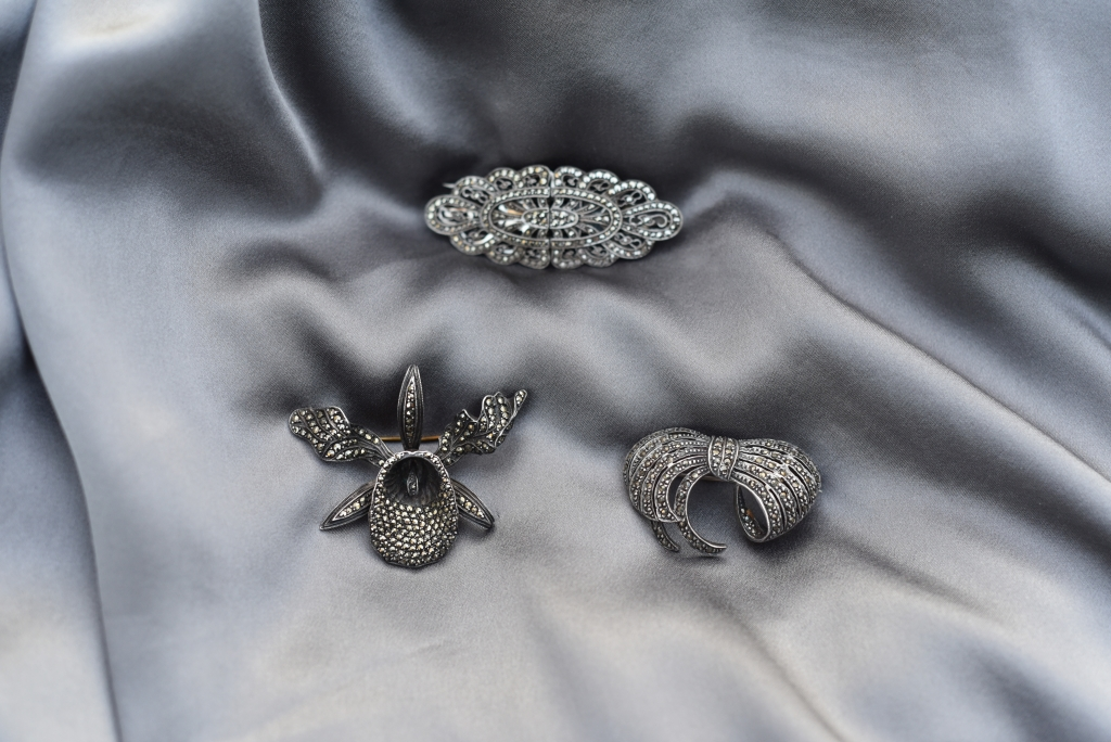Marcasite brooches on silk