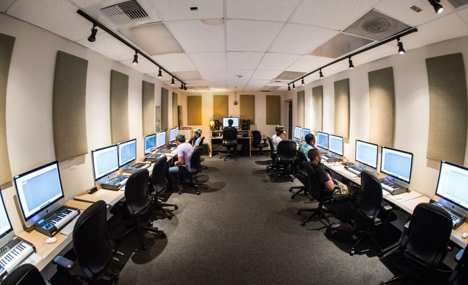 This 16-station lab features Apple's Logic Pro software on 27-inch iMac computers and M-Audio Axiom MIDI controllers. The MIDI Lab introduces students to Logic Pro and the world of the Musical Instrument Digital Interface. Students use this space to create and edit MIDI sequences, employ plug-in software, and learn basic music theory.
