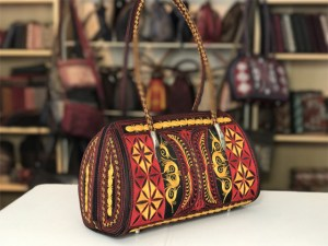 sehat handmade handbag in black red and yellow embroidery by Laga