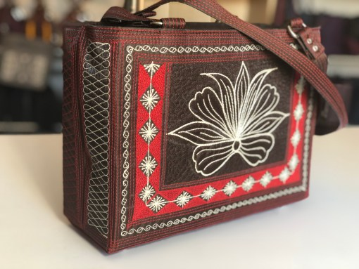 Tenang handmade bag in brown red and cream embroidery by Laga