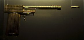 """Le Pistolet d'or avec la balle gravée """"007"""""""