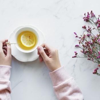 A cup of tea with a lemon slice.