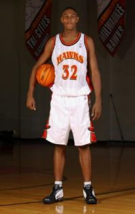 21ème choix des Hawks en 2003