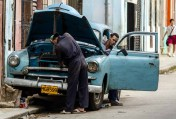 A sky-blue vintage Chevy pulls up and the students ask, in Spanish, if the driver can take them to an intersection about five straight miles down the road. He assents and they pile in and take off, the tropical early spring breeze blowing through the Chevy's open windows.