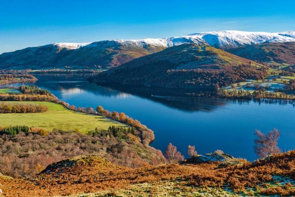 Coloured photography print of the Ullswater lake in Cumbria, taken in winter by local photographer Andy Bell.