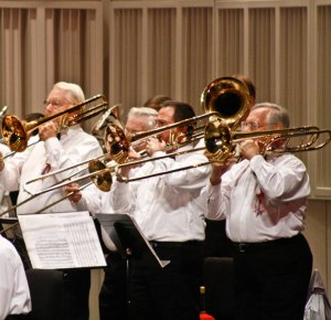 trombones playing with the Lakeland Concert Band