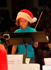 child conducting Lakeland Concert Band at Christmas concert