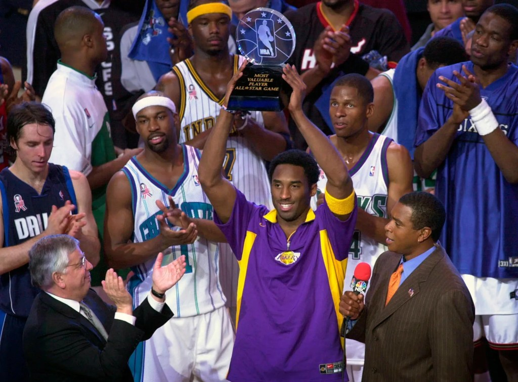 Kobe Bryant holds up his MVP trophy following the 2002 NBA All-Star Game in Philadelphia
