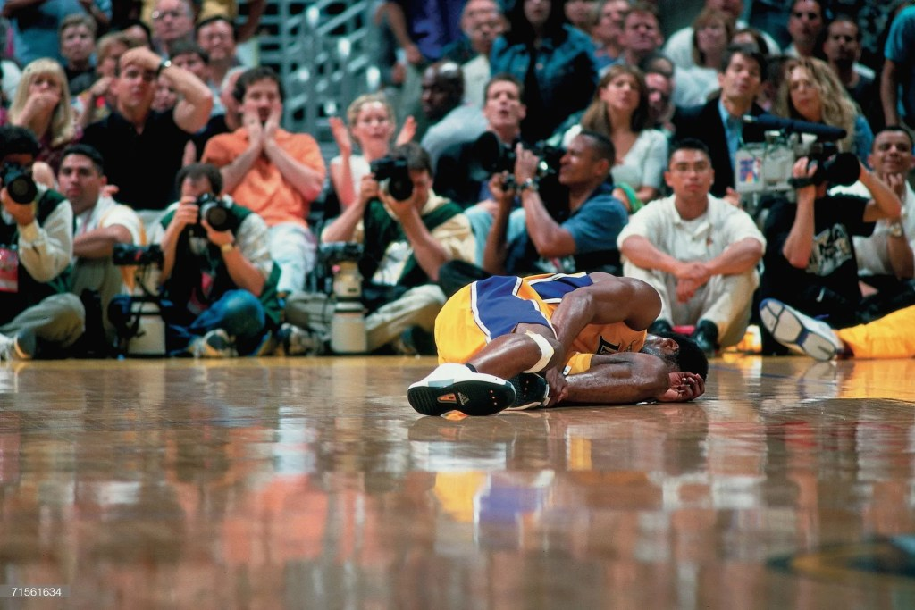 Kobe Bryant #8 of the Los Angeles Lakers grimaces in pain after hurting his ankle against the Indiana Pacers during Game Two of the 2000 NBA Finals on June 9, 2000 at the Staples Center in Los Angeles, California. NOTE TO USER: User expressly acknowledges that, by downloading and or using this photograph, User is consenting to the terms and conditions of the Getty Images License agreement. Mandatory Copyright Notice: Copyright 2000 NBAE