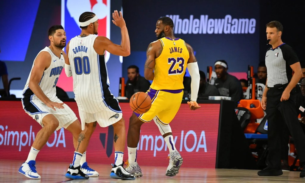 LeBron James #23 of the Los Angeles Lakers passes the ball against the Orlando Magic during a scrimmage on July 25, 2020 at HP Field House at ESPN Wide World of Sports in Orlando, Florida.