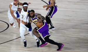 Los Angeles Lakers forward LeBron James (23) drives to the basket against Indiana Pacers guard Aaron Holiday (3) during the fourth quarter of an NBA basketball game Saturday, Aug. 8, 2020, in Lake Buena Vista, Fla.