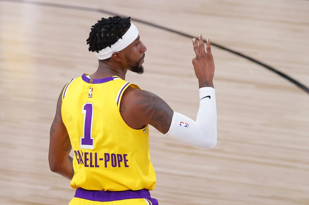Los Angeles Lakers' Kentavious Caldwell-Pope reacts after his three-point basket during the third quarter of Game 2 of an NBA basketball first-round playoff series against the Portland Trail Blazers, Thursday, Aug. 20, 2020, in Lake Buena Vista, Fla.