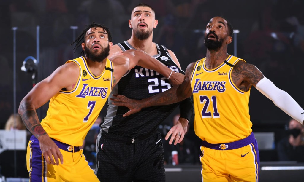 JaVale McGee #7, J. R. Smith #21 of the Los Angeles Lakers, and Alex Len #25 of the Sacramento Kings fights for position to grab the rebound on August 13, 2020