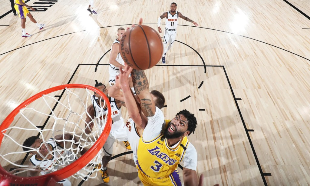 Anthony Davis #3 of the Los Angeles Lakers grabs the rebound against the Denver Nuggets on August 10, 2020