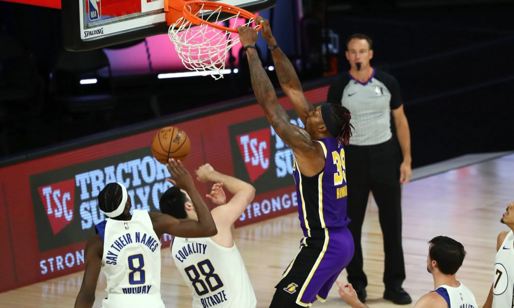 Dwight Howard #39 of the Los Angeles Lakers dunks the ball against Justin Holiday #8 and Goga Bitadze #88 of the Indiana Pacers during the fourth quarter on August 8, 2020