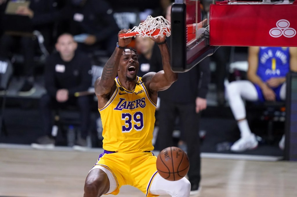 Los Angeles Lakers center Dwight Howard (39) dunks the ball during the second half an NBA conference final playoff basketball game against the Denver Nuggets on Friday, Sept. 18, 2020, in Lake Buena Vista,