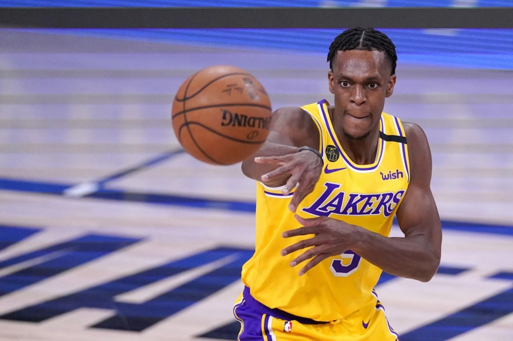 Los Angeles Lakers guard Rajon Rondo (9) makes a pass during the second half an NBA conference final playoff basketball game against the Denver Nuggets on Friday, Sept. 18, 2020, in Lake Buena Vista,