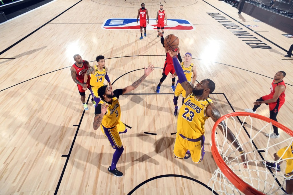 LeBron James #23 of the Los Angeles Lakers reaches for the ball during the game against the Houston Rockets during Game Four of the Western Conference Semifinals of the NBA Playoffs on September 10, 2020