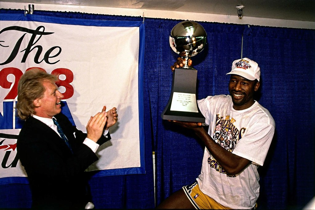 James Worthy #42 of the Los Angeles Lakers holds the 1988 NBA Championship MVP Trophy at the Great Western Forum in Los Angeles, California. The Lakers defeated the Detroit Pistons in seven for the 1988 NBA Championship, becoming the first team in two decades to repeat as champion.