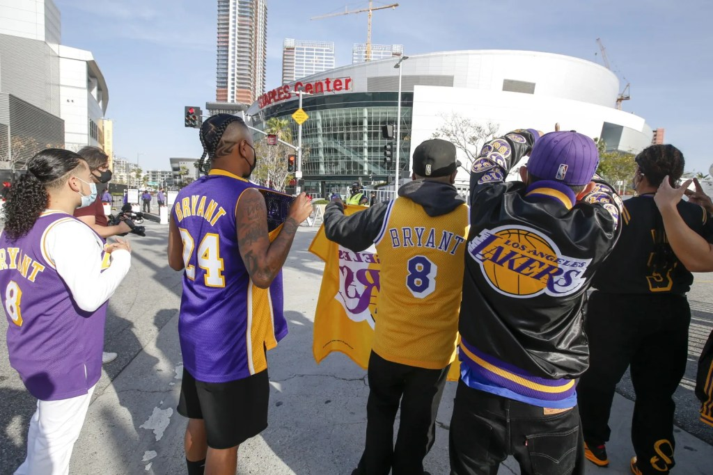 Fans gather outside the STAPLES before an NBA basketball game between the Boston Celtics and the Los Angeles Lakers