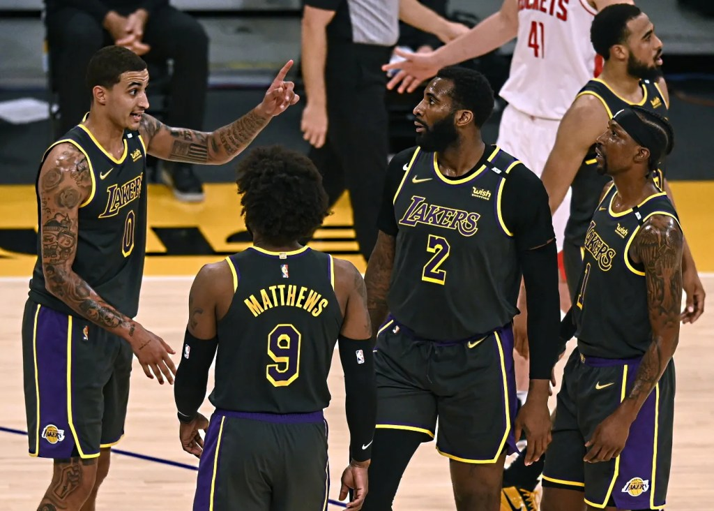 Kyle Kuzma with Wesley Matthews, Andre Drummond and Kentavious Caldwell-Pope; Los Angeles Lakers vs Houston Rockets on May 12, 2021 at STAPLES Center in Los Angeles, California. (Harry How, Getty Images)