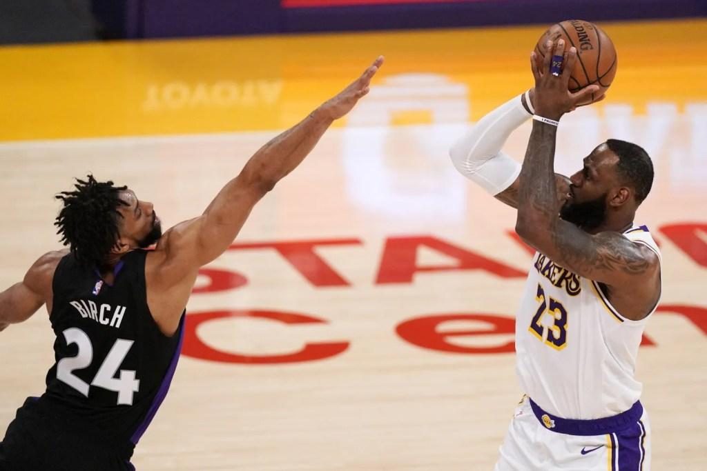 LeBron James and Khem Birch, Los Angeles Lakers vs Toronto Raptors