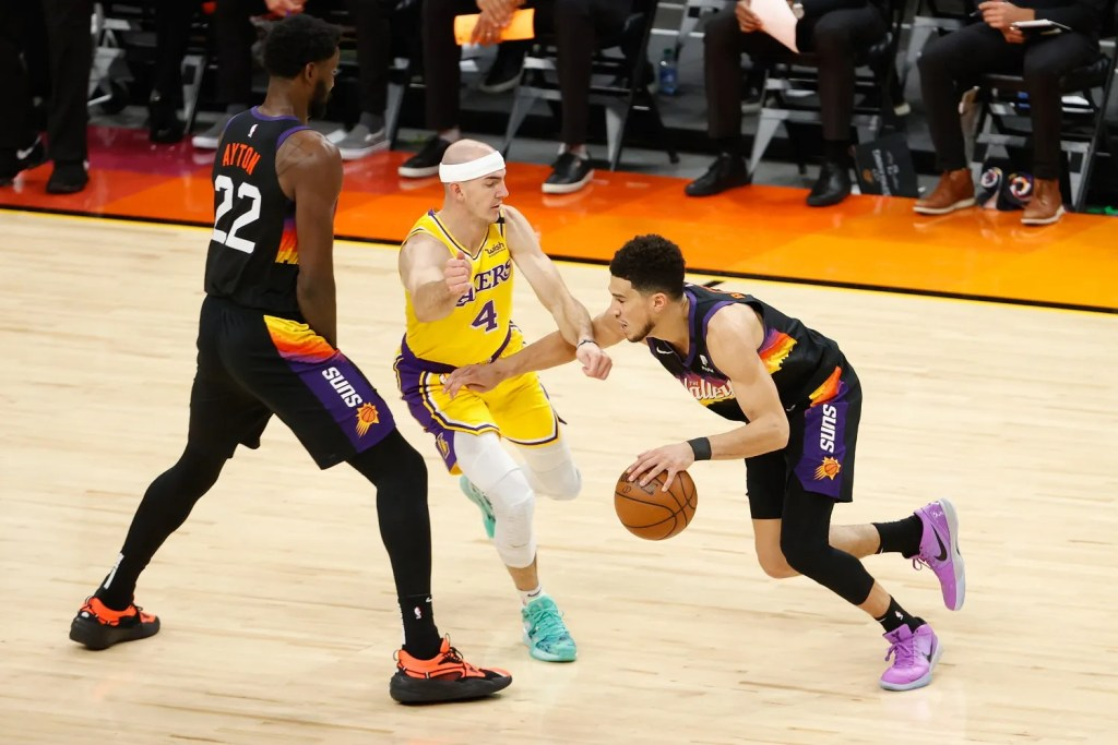 Deandre Ayton, Alex Caruso and Devin Booker. Los Angeles Lakers vs Phoenix Suns